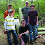 Fifth and Sixth Grade Science Teacher and Environmental Program Director, David Kline (back left) and WPLT's Vice President and Education Committee Chair, Mike Groman (back right) supervised the riparian buffer restoration project, assisted by sixth grade students from the Montgomery School.