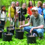 Mike Groman and some of the Montgomery School students prepare to plant some of the large trees.