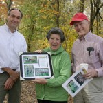 Mike Groman presents Marjorie and Arthur Miller, Jr. with a commemorative gift at the opening of the new Pickering Creek Trail in West Pikeland.